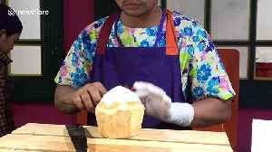 Chef shows how to remove coconut meat and water in one piece [Video]