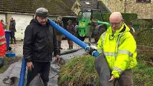 Storm Dennis: Residents in Yorkshire build 'AquaDam' [Video]