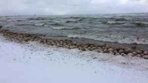 Thousands Of Ice Balls Wash Ashore On Lake Michigan In Rare Weather Event [Video]