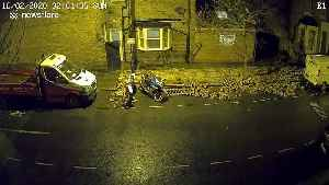 CCTV captures Storm Dennis topple brick wall and take out lamppost in London (INCLUDES DAY SHOTS) [Video]