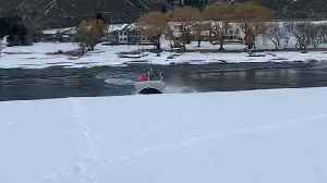 Boat Slides Through Snow Between Lakes [Video]