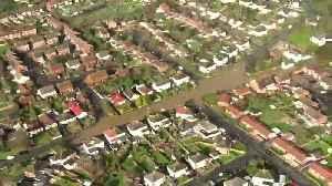Mass floods sweep suburban Britain in Storm Dennis' wake [Video]
