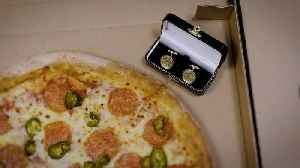 Gold pizza cufflinks aim to take a slice of leap day romance [Video]