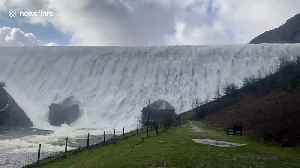 Gallons of water pours from overflowing Welsh dam after Storm Dennis rainfall [Video]