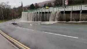 Storm Dennis causes UK car park to overflow resembling a waterfall [Video]