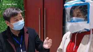 Chinese company develops protective hood for medical staff fighting coronavirus [Video]