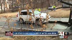 Water main break sinks car in the Northland [Video]