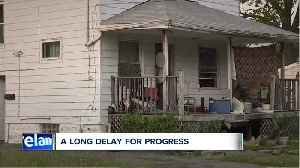 After a year and a half, a squatter home is gone from a block trying to build itself back up [Video]