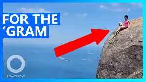 Tourist takes risky shot on the edge of Rio cliff [Video]