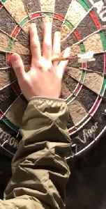 Woman Throws a Perfect Bullseye in Darts Game [Video]