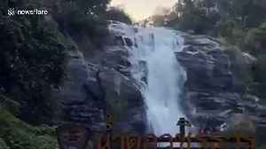 Thai climber rescues hapless dog stuck on 260ft high waterfall [Video]