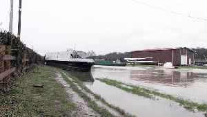 Canal boat left stranded on path after Storm Dennis flooding in Derbyshire [Video]