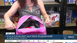 COACH silent auction fundraiser gives to needy kids [Video]