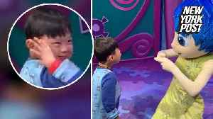News video: Sign language meeting between deaf boy and Disney performer