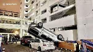 Thai driver shunts pickup truck off multi-storey car park before fleeing scene [Video]