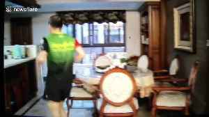 Quarantined Chinese resident jogs 100 kilometres in his living room in ten hours during coronavirus lockdown [Video]