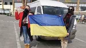 Ukrainians protest over having COVID-19 coronavirus evacuees in their region [Video]