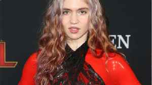 Pregnant Pop Star Grimes Won't Share Gender Of Baby