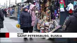 On magnets, mugs and matryoshka dolls, Putin's face still sells [Video]