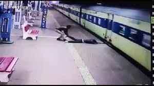 Indian police officer rescues man who slipped boarding moving train [Video]