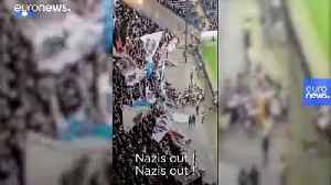 'Nazis out' chant Frankfurt fans after hecklers interrupt minute's silence for Hanau victims [Video]