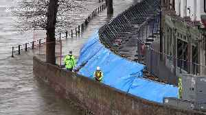 Massive flood barriers erected as 'danger to life' warning issued in west England [Video]