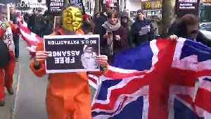 Protesters march for Assange's release [Video]