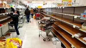 Supermarket shelves stripped bare as coronavirus fears grip Milan [Video]