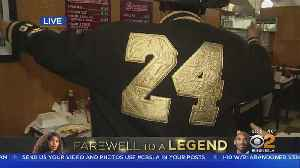 Fans Don Custom-Made Kobe Bryant Gear For Memorial [Video]