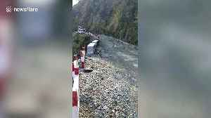 High mountain road collapses during rains, cutting off 80 villages in north India [Video]