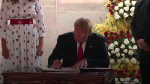 Donald Trump signs guest book at Gandhi memorial
