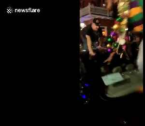 'Mardi Gras is wild!' Men dancing on moving car fall off during insane New Orleans party [Video]