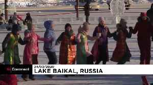 On a frozen Siberian lake, festival-goers mark the Lunar New Year [Video]