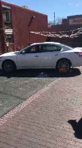 Guy Takes Out Car on Road in Reverse With Parking Boot Stuck on Tire [Video]