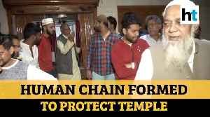 Chand Bagh locals form human chain to protect temple amid Delhi violence [Video]