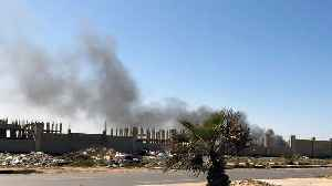 Libya conflict: Heavy shelling around Tripoli's Mitiga airport