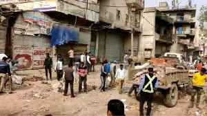 People removing the blockades at Chandbagh area as situation restores to normalcy [Video]