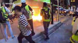 Protesters set fire to a barricade on Nathan road [Video]