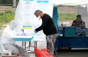 Masked and gloved: Israelis in quarantine from coronavirus vote in election [Video]