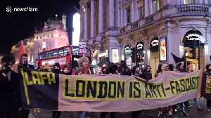 Anti-fascist rally in London directed at Italian deputy PM features dancing clowns amid police intervention [Video]