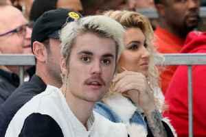 Justin Bieber gives David Beckham a fright on Ellen [Video]