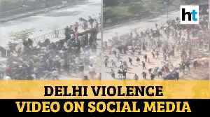 Watch: Alleged video of Delhi violence on social media; cop recounts ordeal [Video]