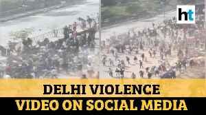 Watch: Alleged video of Delhi violence on social media; cop recounts ordeal [Video]