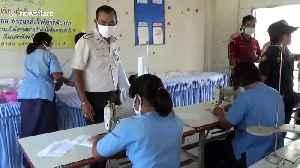 Female prison inmates in Thailand put to work making coronavirus face masks [Video]