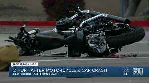 Two hurt after motorcycle and car crash in Mesa [Video]
