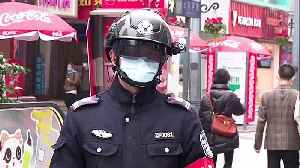 Chinese police wear helmets fitted with infrared device to detect pedestrians' temperature amid coronavirus outbreak [Video]