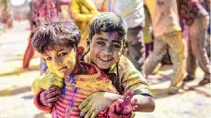 Revelers Celebrate Holi Festival Amid Coronavirus Fears [Video]