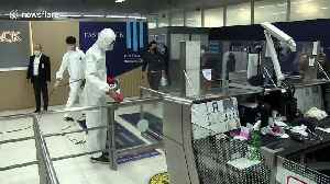 Thai airport disinfected after two workers contract coronavirus [Video]