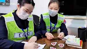 Toll gate staff on Chinese highway draw smiles on their face masks to appear friendly [Video]