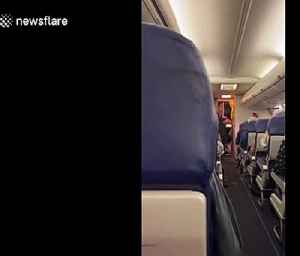 Despite Coronavirus scare, Southwest employee sings 'proud to be an American' during a flight [Video]